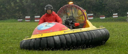 Driving MAD-81L hovercraft on grassfield
